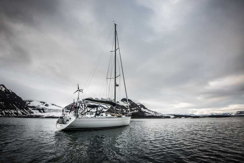 Barba and crew resting at anchor, in Horsund, Svalbard.